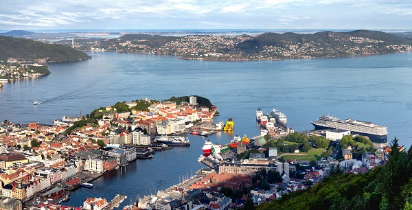 Beautiful Panoramic Of The Bay In Bergen, Norway From A High Vantage Point With Cruise Ships And Other Watercraft Docked.
